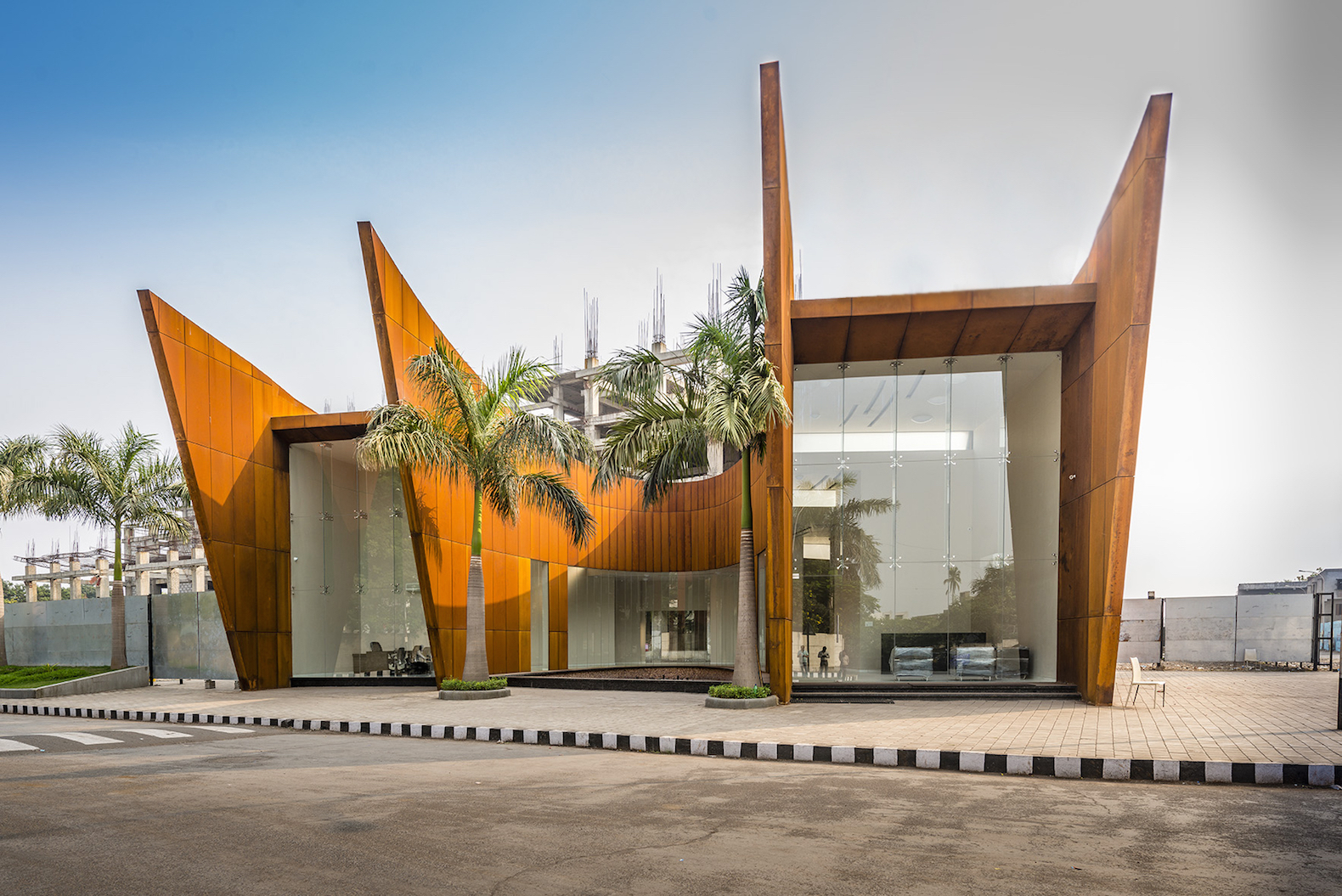 Curvaceous Corten Steel Office Building Beats The Heat With Solar