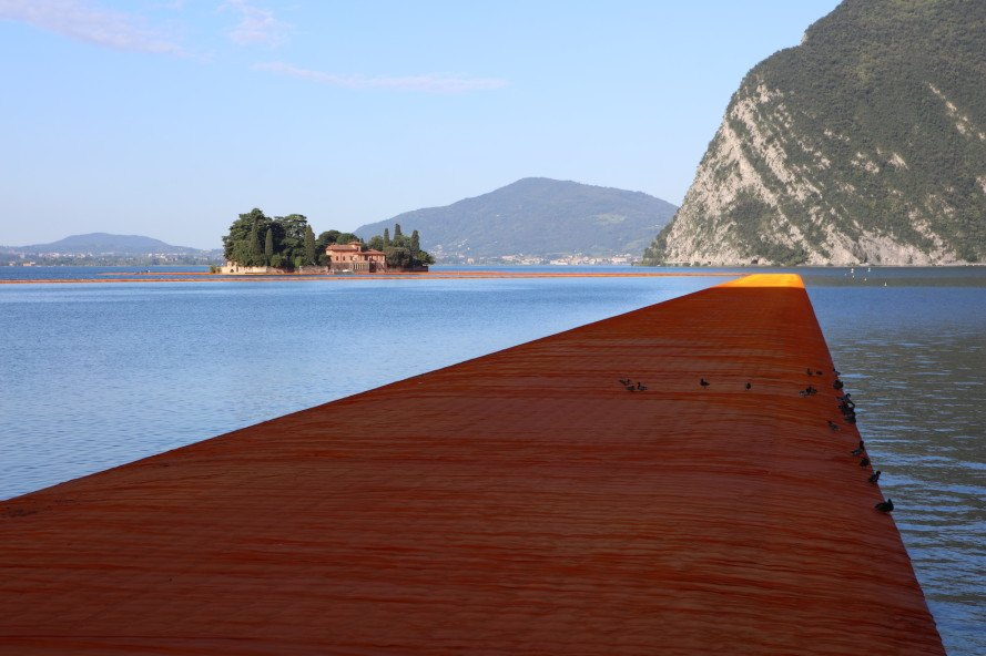 The Floating Piers by Christo, Floating Piers in Lake Iseo, Floating Piers in Italy, large scale art by Christo, temporary large scale art installation