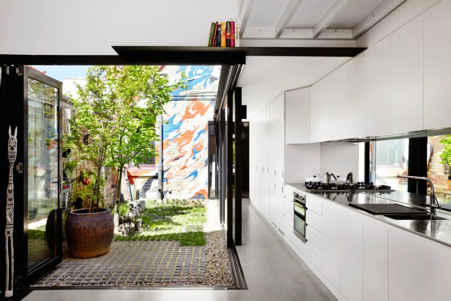 Austin Maynard Architects, green renovation, Alfred House, Australia, home extension, green courtyard, gable roof, white extension,
