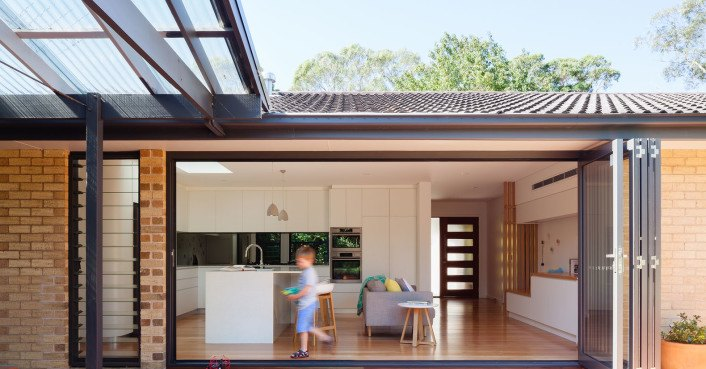 New protective timber slats shield the renovated escu for Homes with verandahs all around
