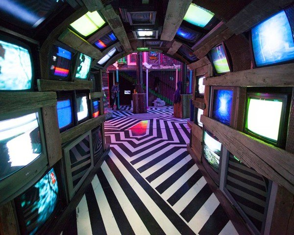 Meow Wolf, Game of Thrones creator, real life video game, The House of Eternal Return, immersive art, immersive space, glow in the dark, house, Santa Fe, recycled bowling alley
