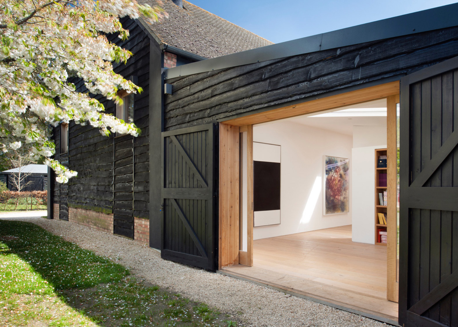 Beautiful converted barn hides a secret library in Oxfordshire