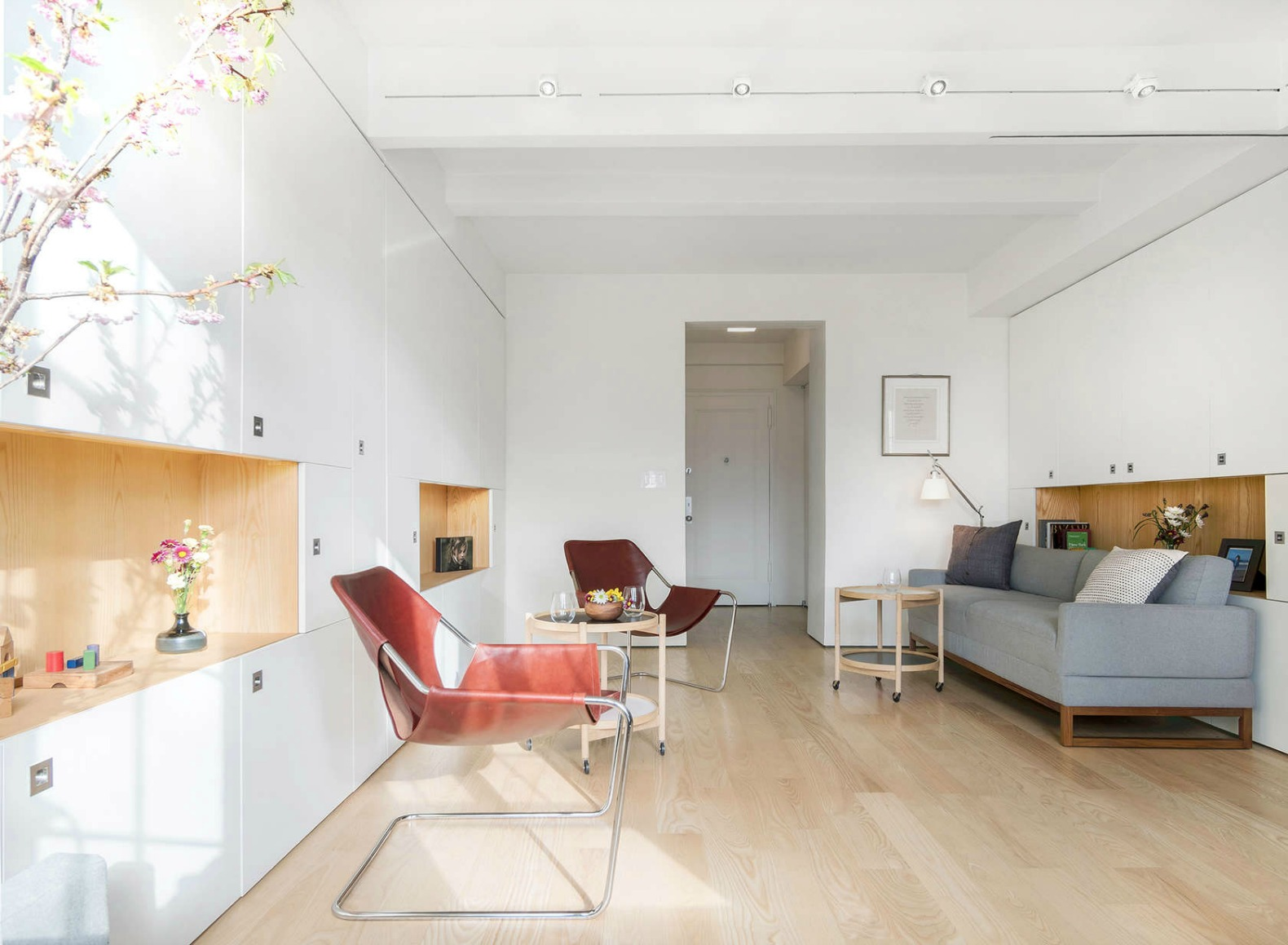 400-square-foot apartment uses clever pivot wall to divide space in multiple ways