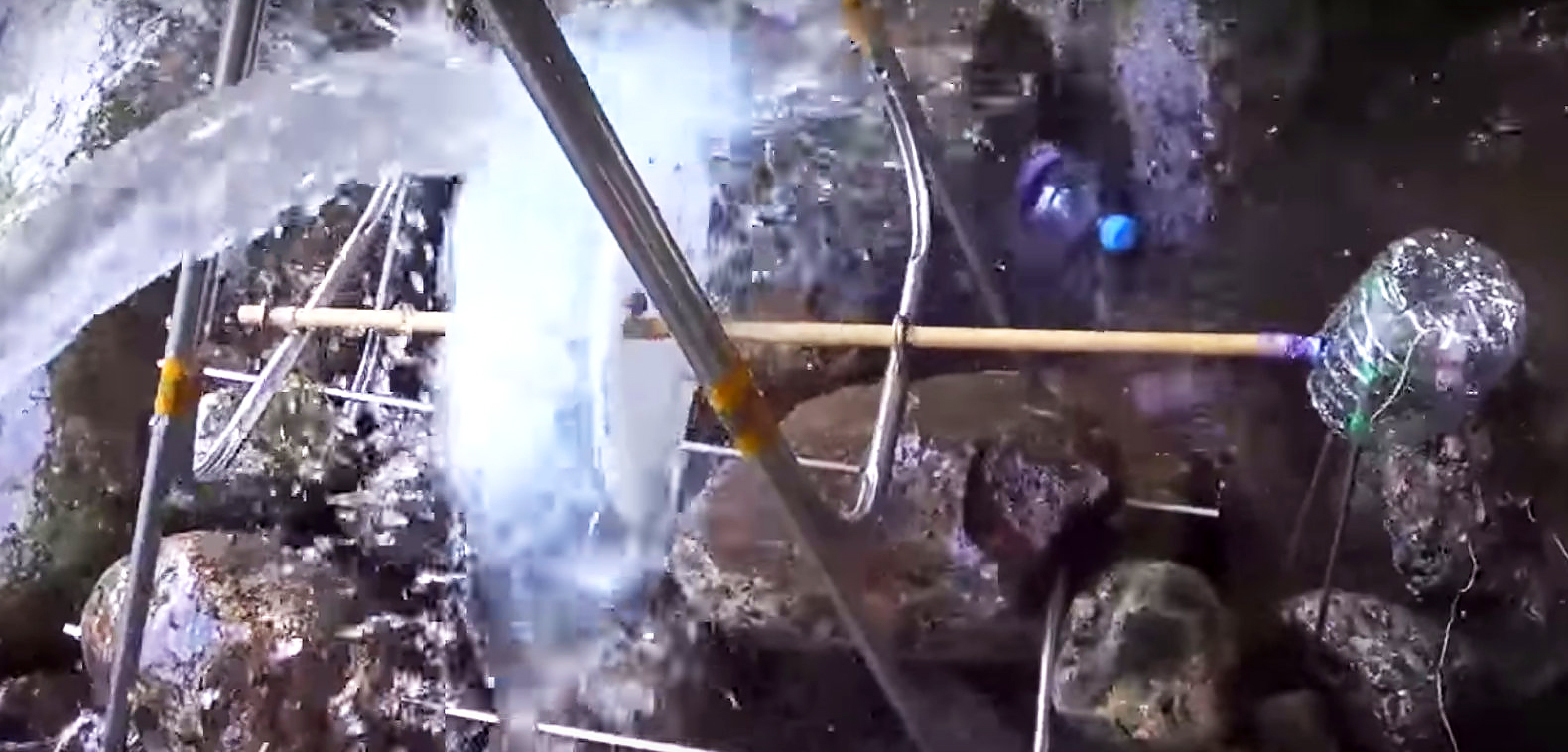 DIY hydroelectric water wheel uses recycled plastic bottles to generate free electricity