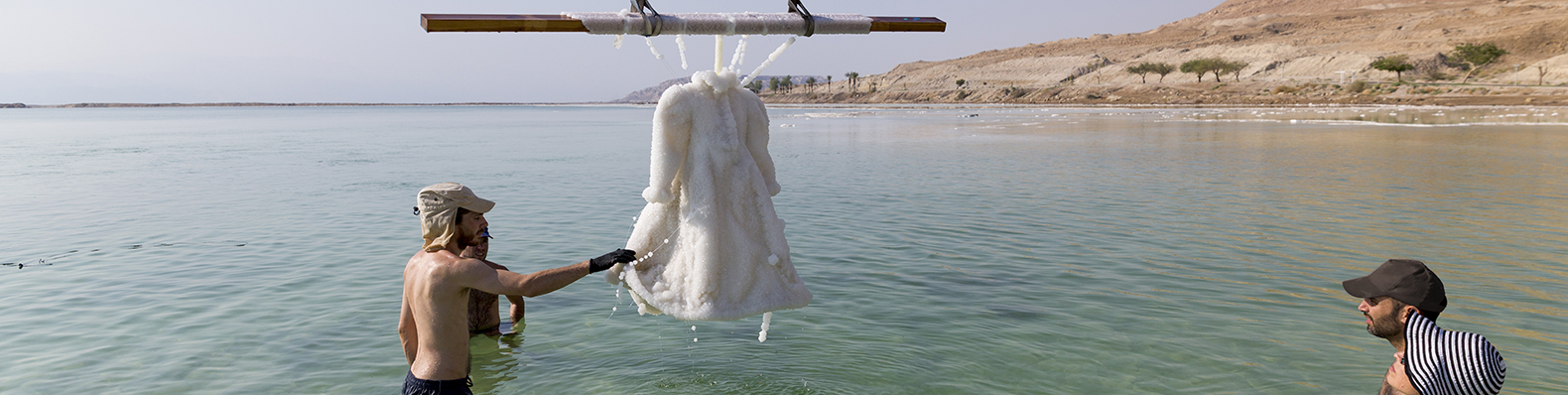 Dress submerged in the Dead Sea transforms into a glittering crystalline gown