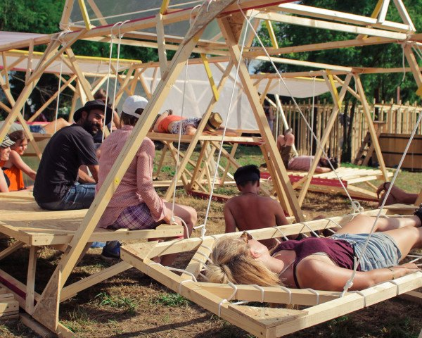 Hello Wood, Hello Wood village, Hungary, temporary structures, timber structures, prefab architecture, prefab wood, migrant housing, outdoor amphitheater, communal spaces, charred wood, green architecture, architecture students