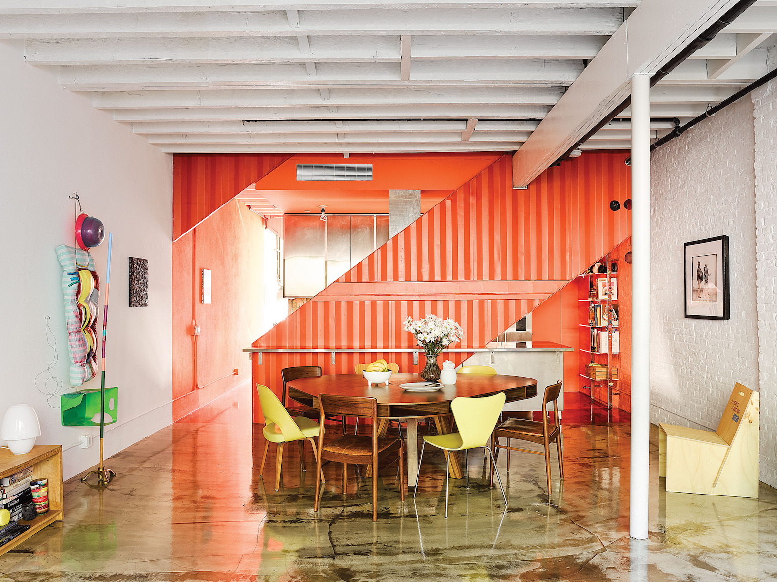 Repurposed shipping containers inject funky and unexpected color to a historic home renovation