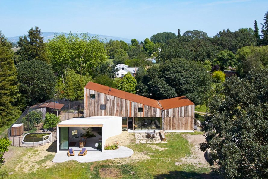 Mork-Ulnes Architects, recycled barn, recycled artist studio, Meier Road project, California, recycled wood, modern addition, free-range chicken, plants growing inside