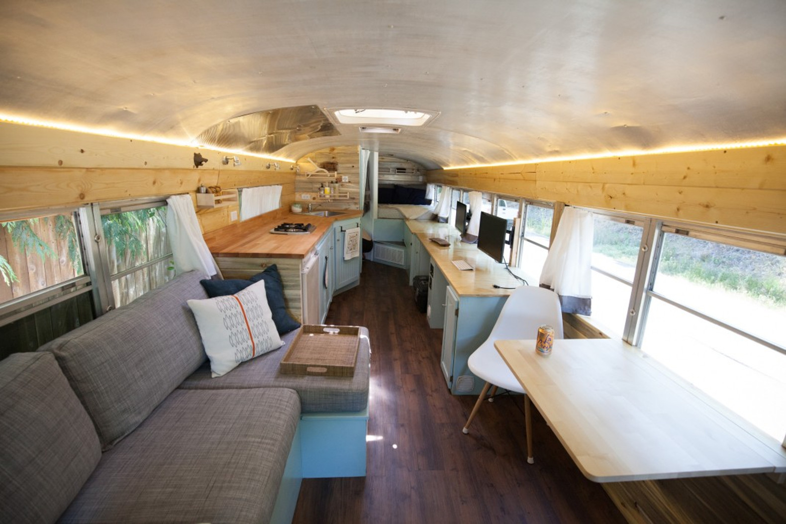 tiny house school bus. This Couple Ditched Their Tech Jobs For Life And Work On The Road In A Converted School Bus Tiny House -