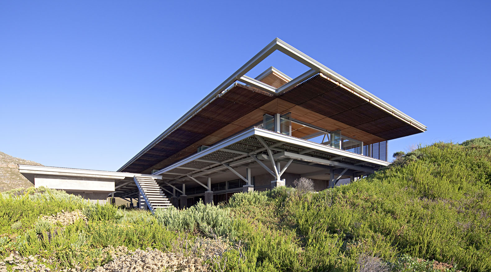Cape Town Beach Home Controls Natural Light With Powerful Hydraulic Shutters Rooiels Beach House ...