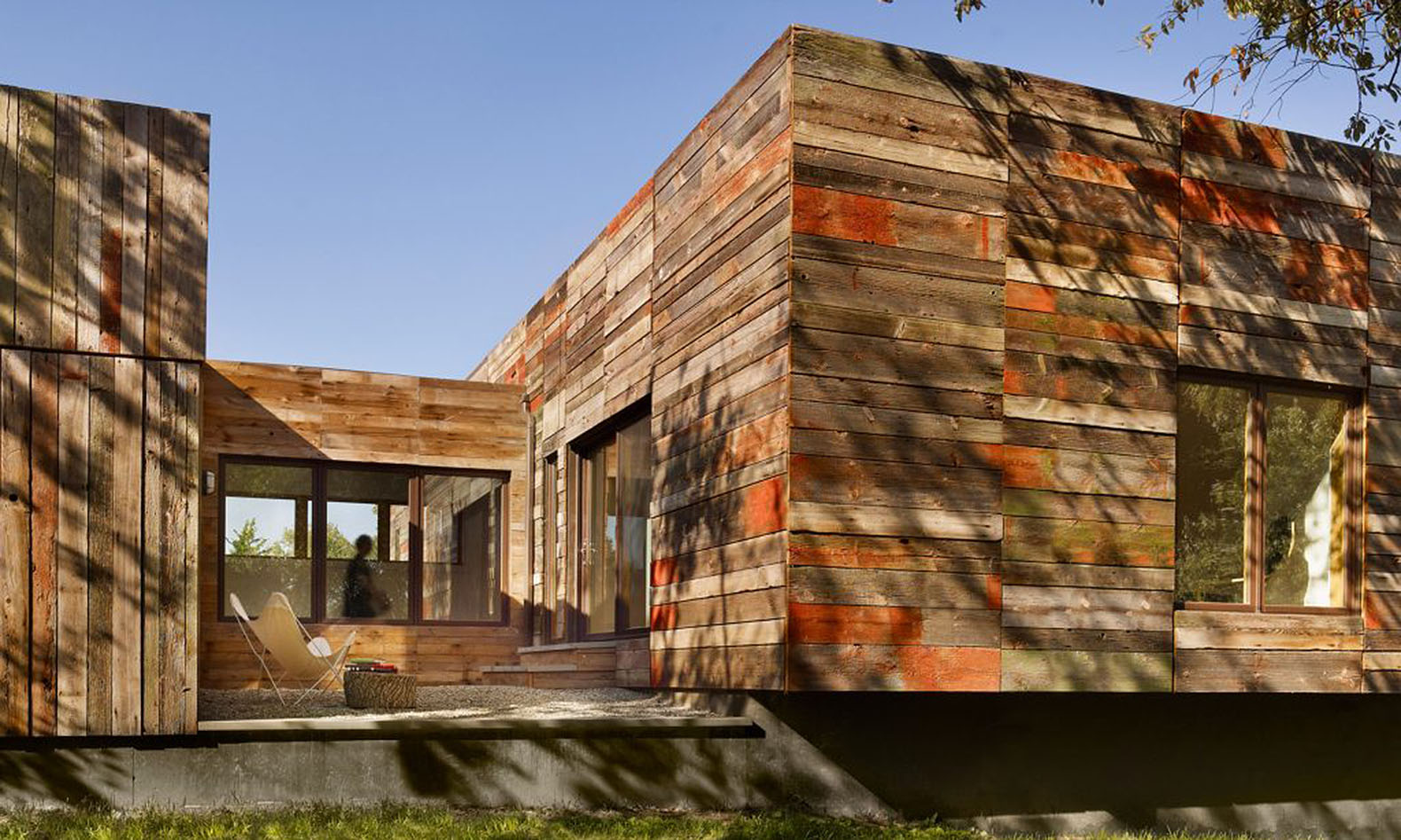 Vernacular inspired delaware home built with recycled barn for Wood barn construction