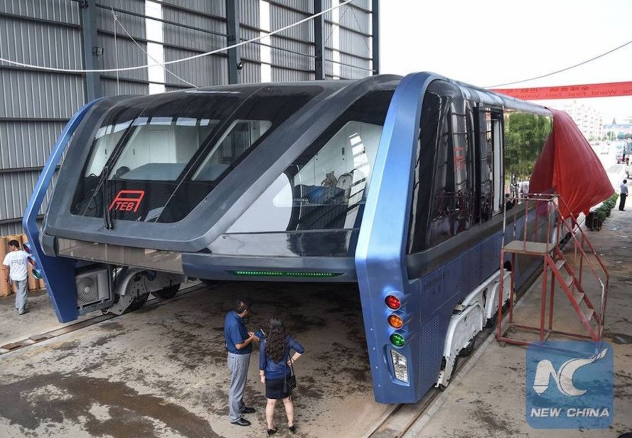 straddling bus prototype, bus beats traffic, bus soars above traffic, elevated bus goes above cars, Transit Elevated Bus prototype, Transit Elevated Bus test run, China straddling bus