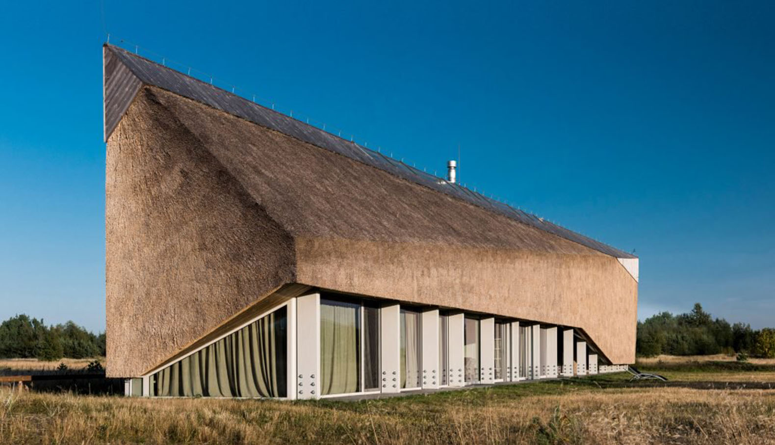 Thatch Roofed Dune House Mimics The Windswept Dunes And