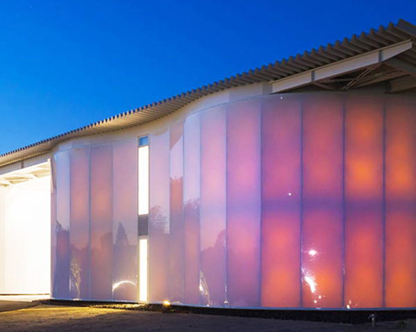 Kengo Kuma's colorful new Sogokagu pavilion glows from