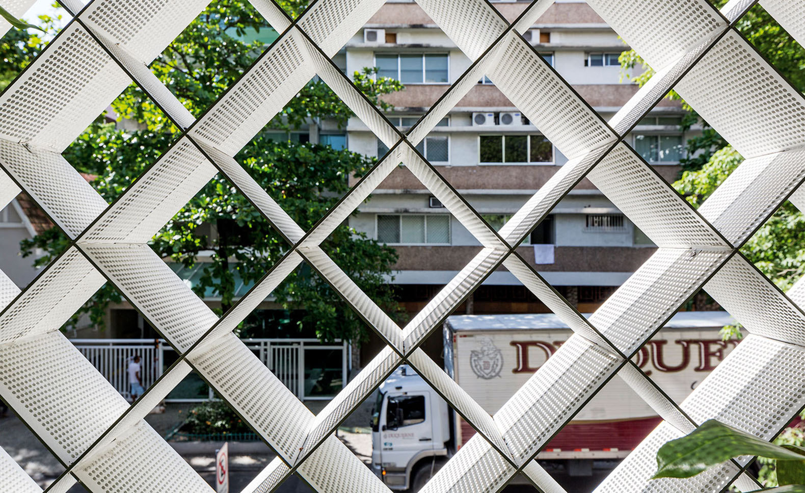 A beautiful perforated facade filters natural light into the