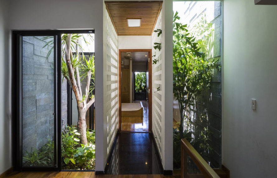 Garden House in Vietnam, Ho Khue Architects, green-roofed narrow house, Vietnam, natural ventilation, Vietnam, green architecture, vertical garden, green roof, perforated brick, brickwork, natural light, planters