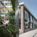 Nature filled office takes over a former factory building for Space 120 architects
