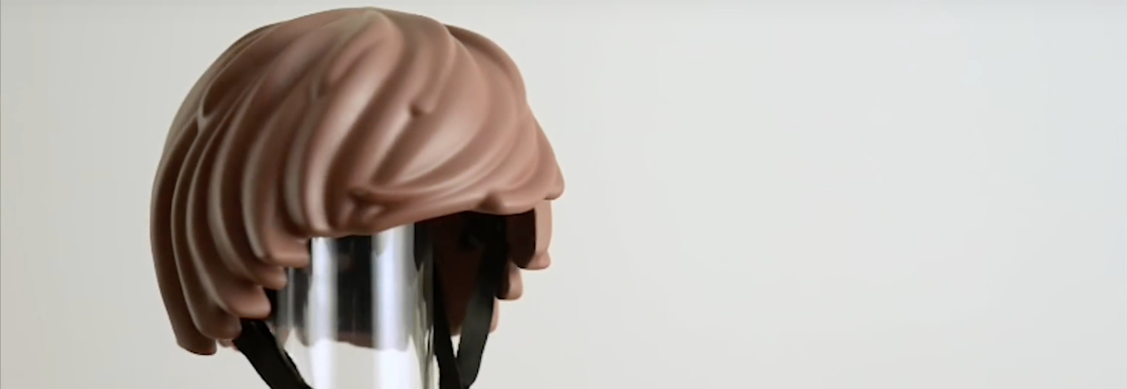 3D-printed Playmobil hair helmet makes bike safety more fun for kids