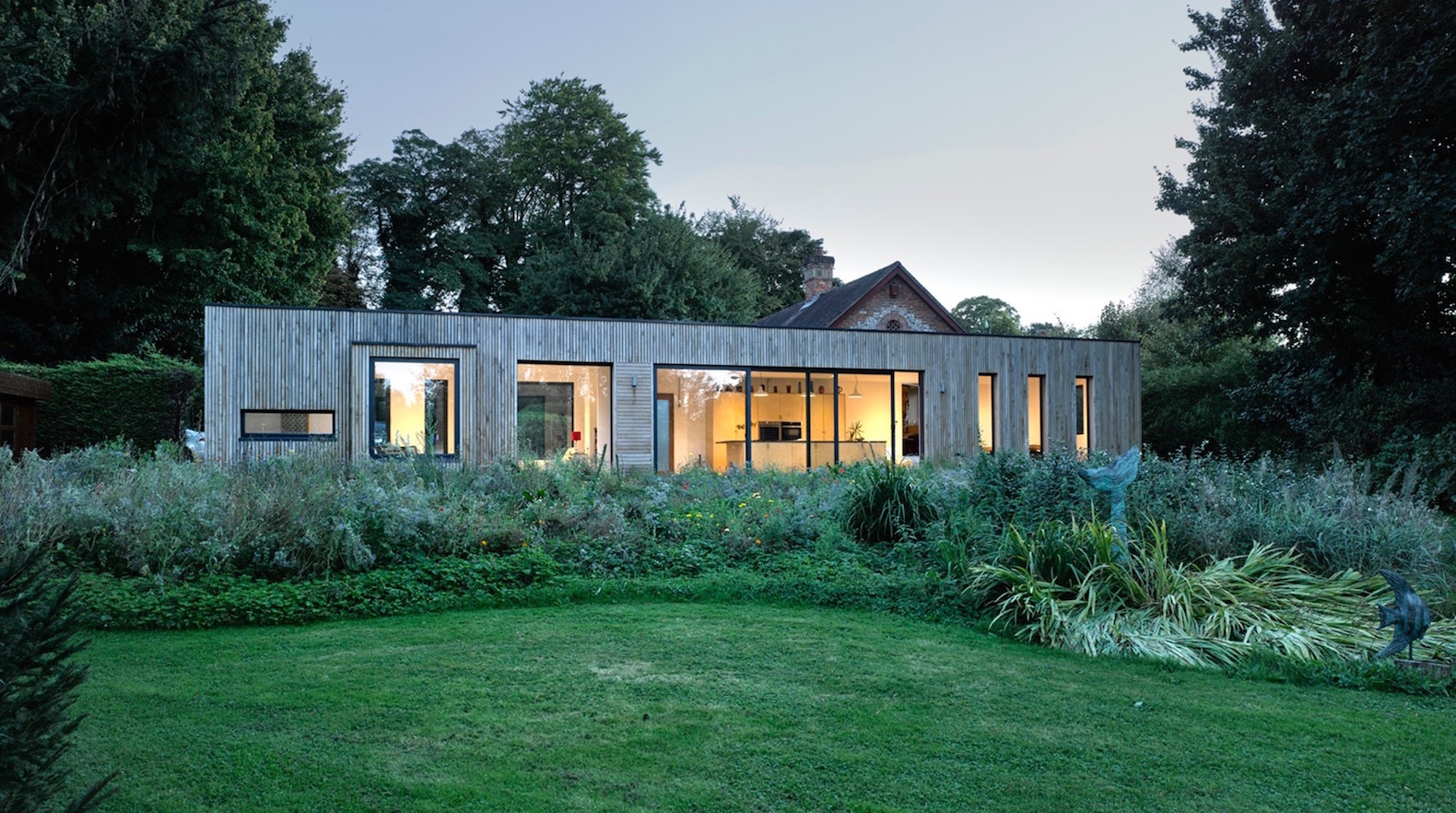Beautiful prefab box is a modern light-filled extension to a historic barn