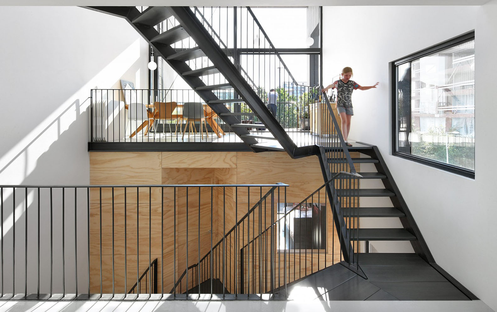 This wooden loft house has a seamless layout that for Residential atrium