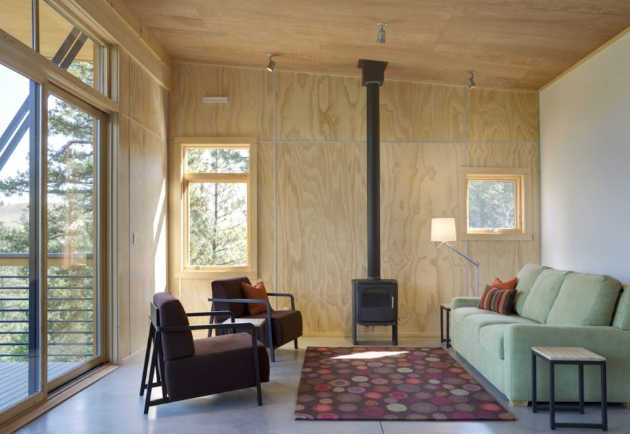 Pine Forest Cabin by Prentiss Balance Wickline Architects, cabin in Methow Valley, affordable modern cabin design, cabin design on a budget, cabin with a small footprint, cantilevered cabin design