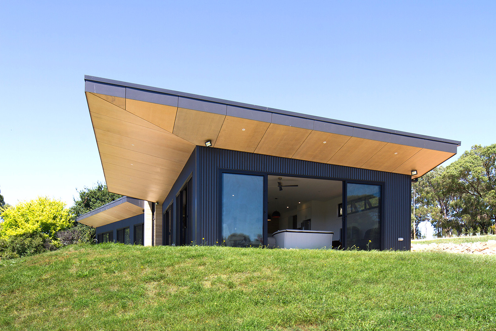 Rammed earth walls form the core of this modern australian home