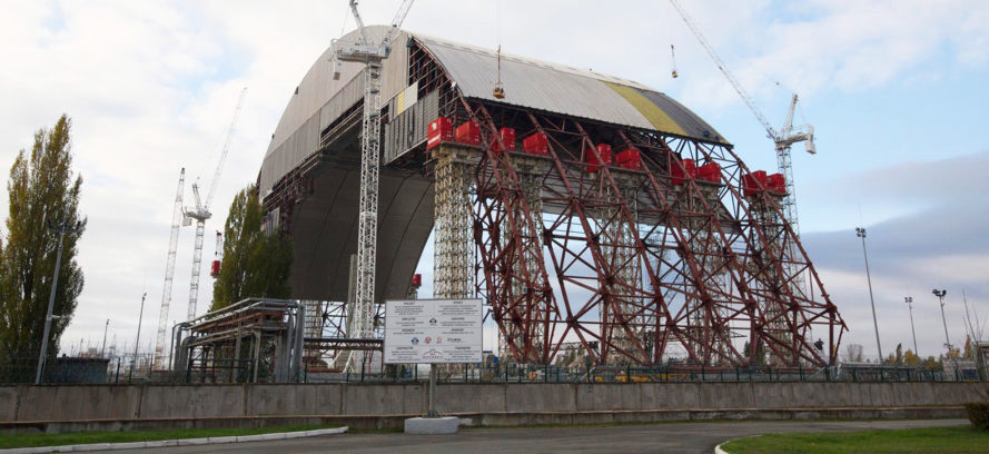 chernobyl reactor covered by largest moveable metal structure, giant metal arch covers chernobyl, chernobyl nuclear disaster, chernobyl, nuclear meltdown, radiation