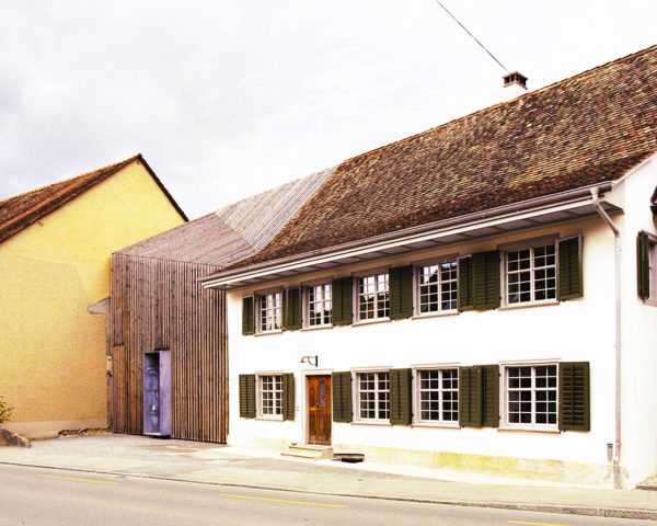 Marazzi Reinhardt, wooden façade, green home extension, Haus Zur Blume, historical home extension, Switzerland, slatted wooden façade, modern extension
