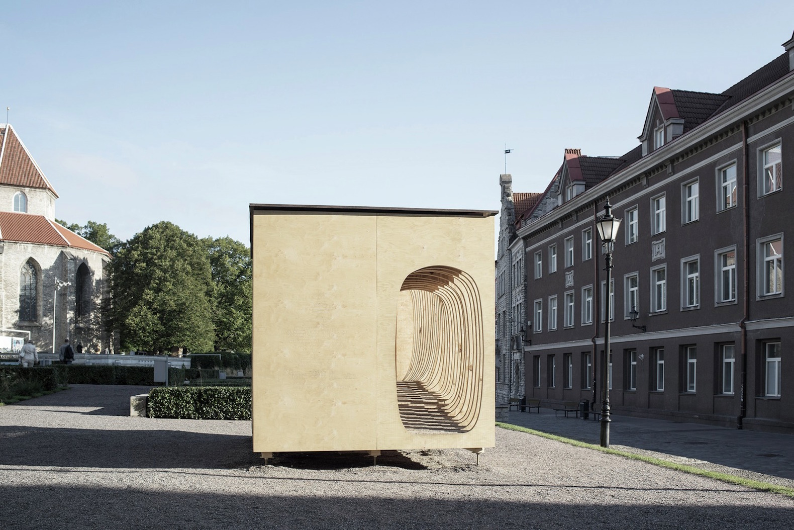Cozy READER shelter made from plywood offers escape into the world of books
