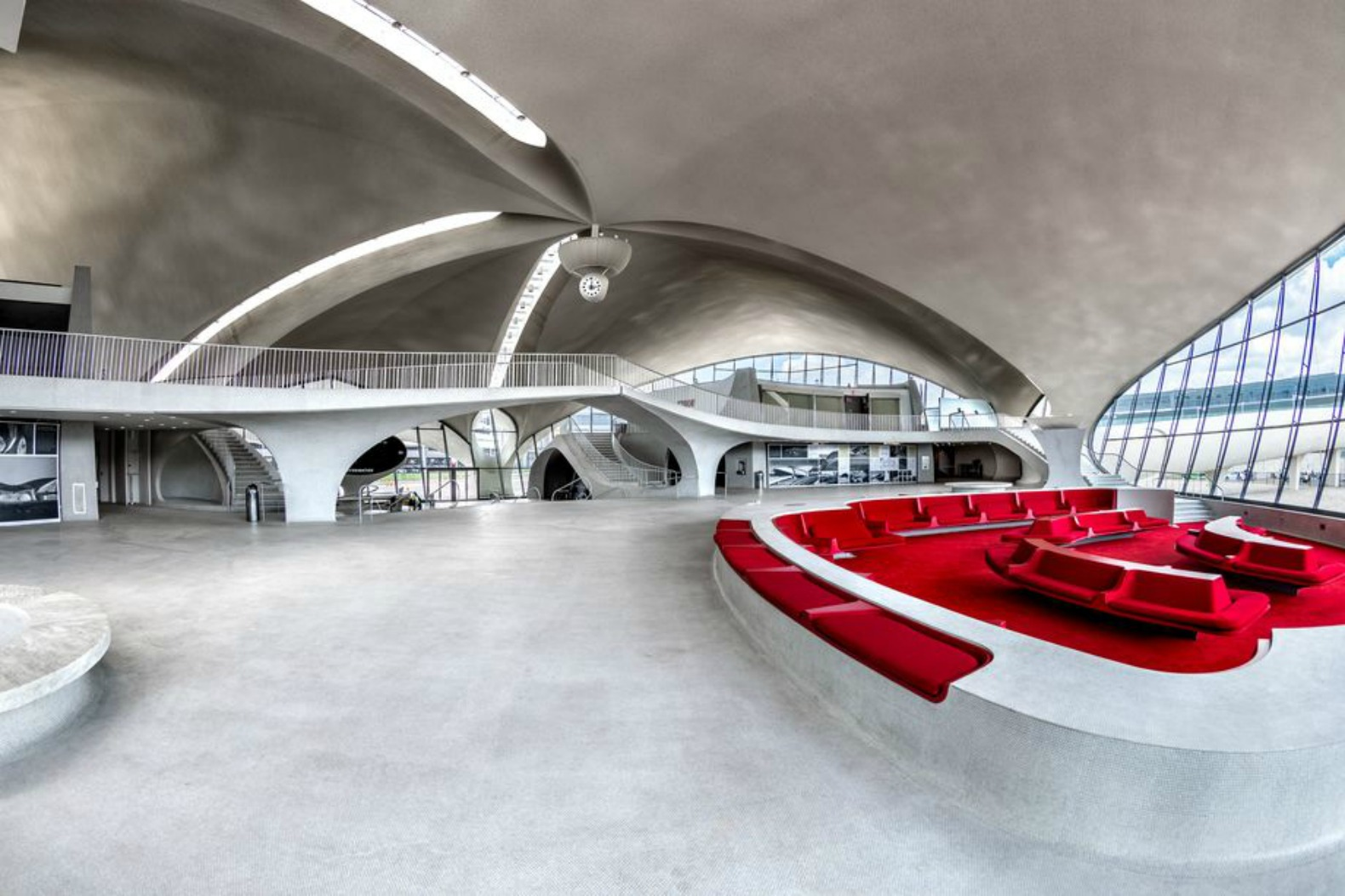 Transformation of iconic twa flight center into swanky for Jfk airport hotel inside terminal