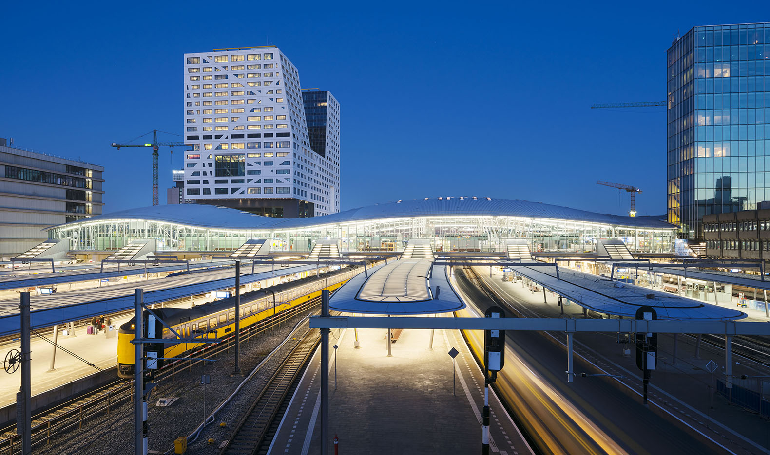 Designed by Benthem Crouwel Architects, the new Utrecht Central Station  will house train, bus and tram platforms under one undulating roof.