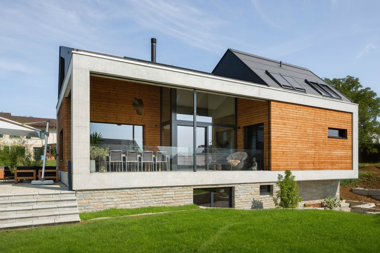 Natural Material Palette Brings Warmth To Minimalist Swiss Home