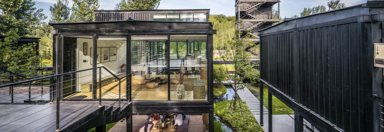 Spectacular new shipping container museum nestles near for Tall shipping container
