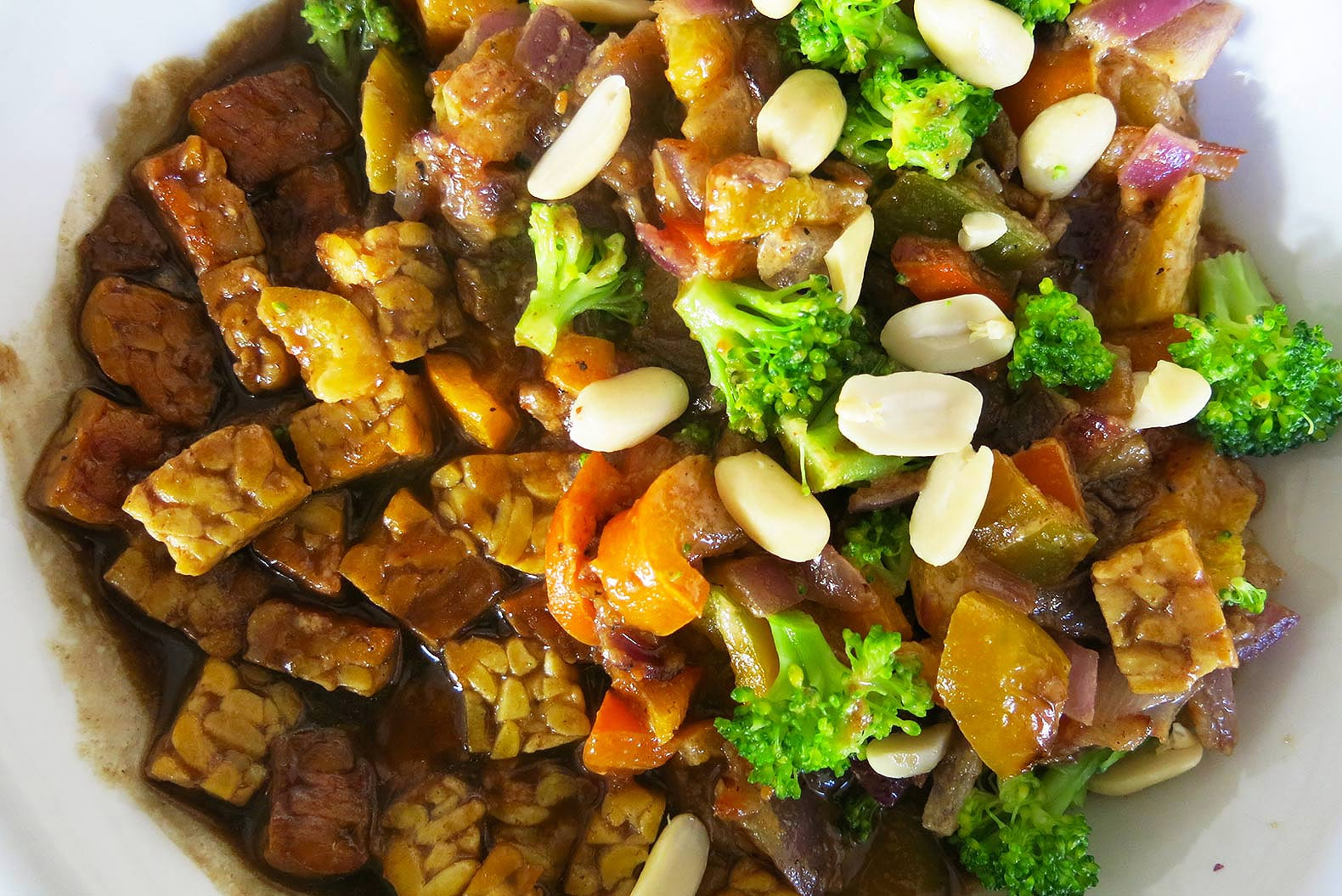 HOW TO: Cook protein-rich, vegan stir-fry with tempeh and peanut sauce