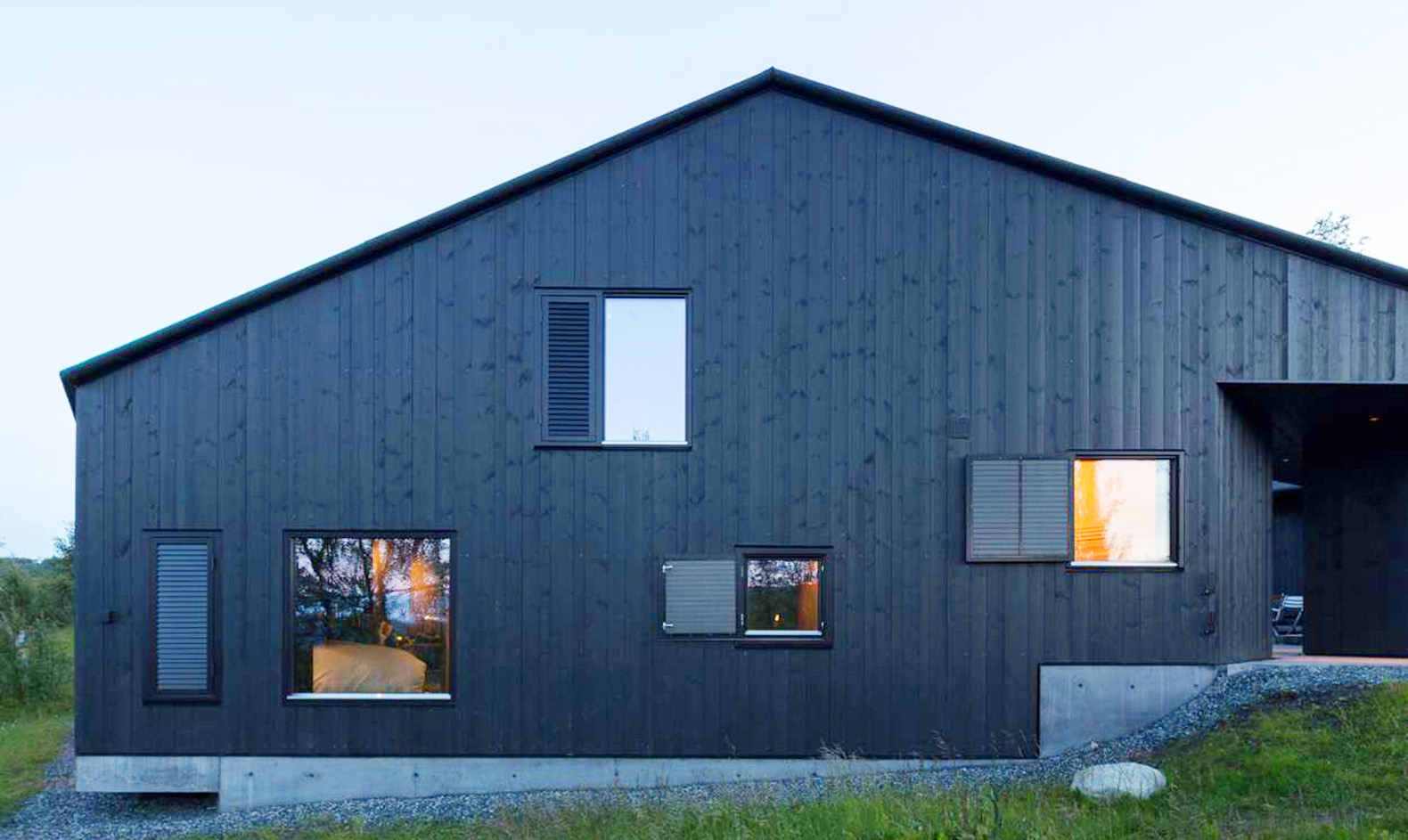All-black timber Geilo Cabin makes the most of the winter sunlight
