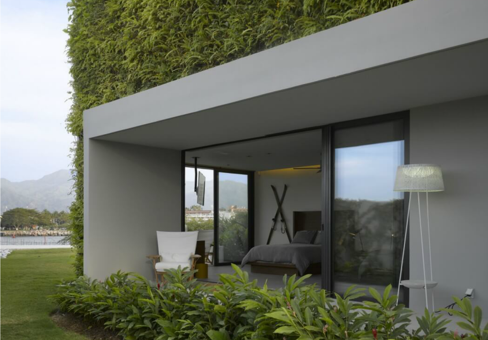 insulating veil of plants envelops stunning vallarta house in mexico