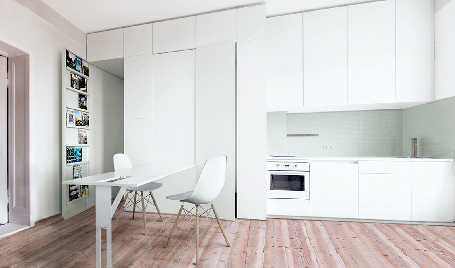 Furniture folds out of the walls in this tiny transforming apartment