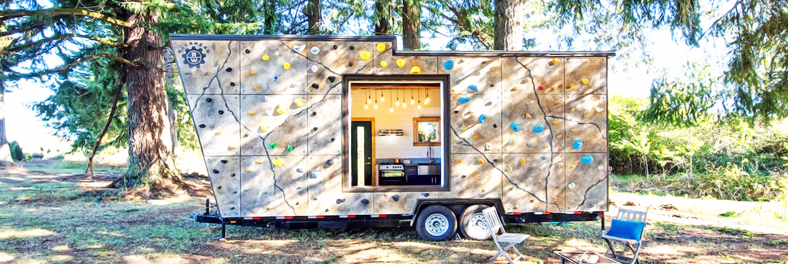 The sapphire house from tiny heirloom tiny house town - Rock Climbing Walls Cover This Tiny Home Built For Adventure Lovers