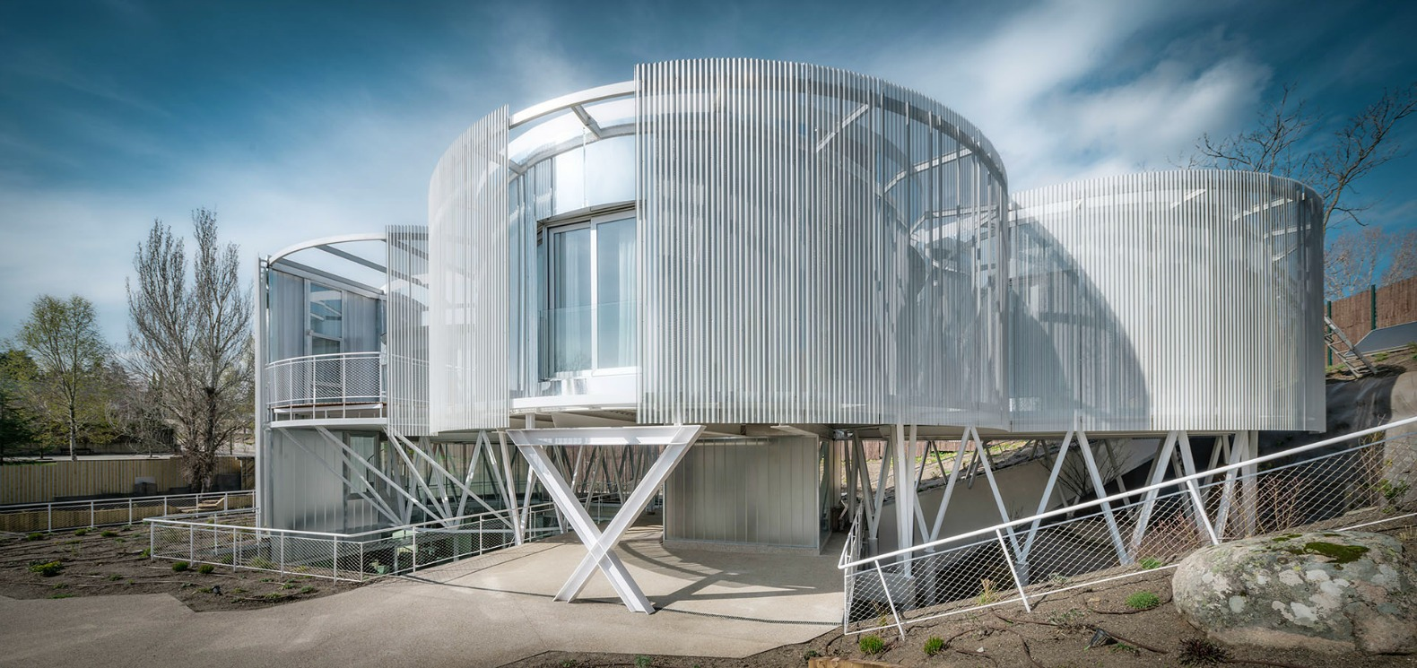 Futuristic home made of massive steel cylinders hides two houses in one