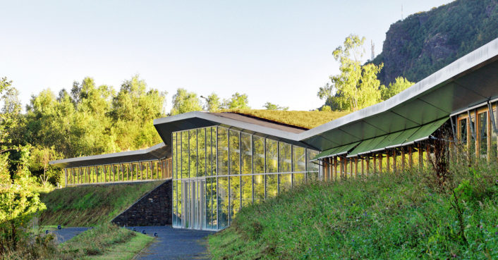 Amazing green-roofed school melts into the mountains of France