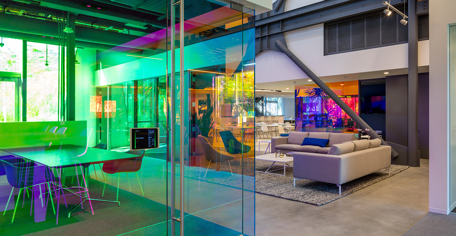 Color changing glass bathes the interior of the new canvas for Interior architecture