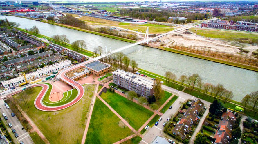 New dutch bicycle bridge doubles as a green roof for a for Dutch landscape architects