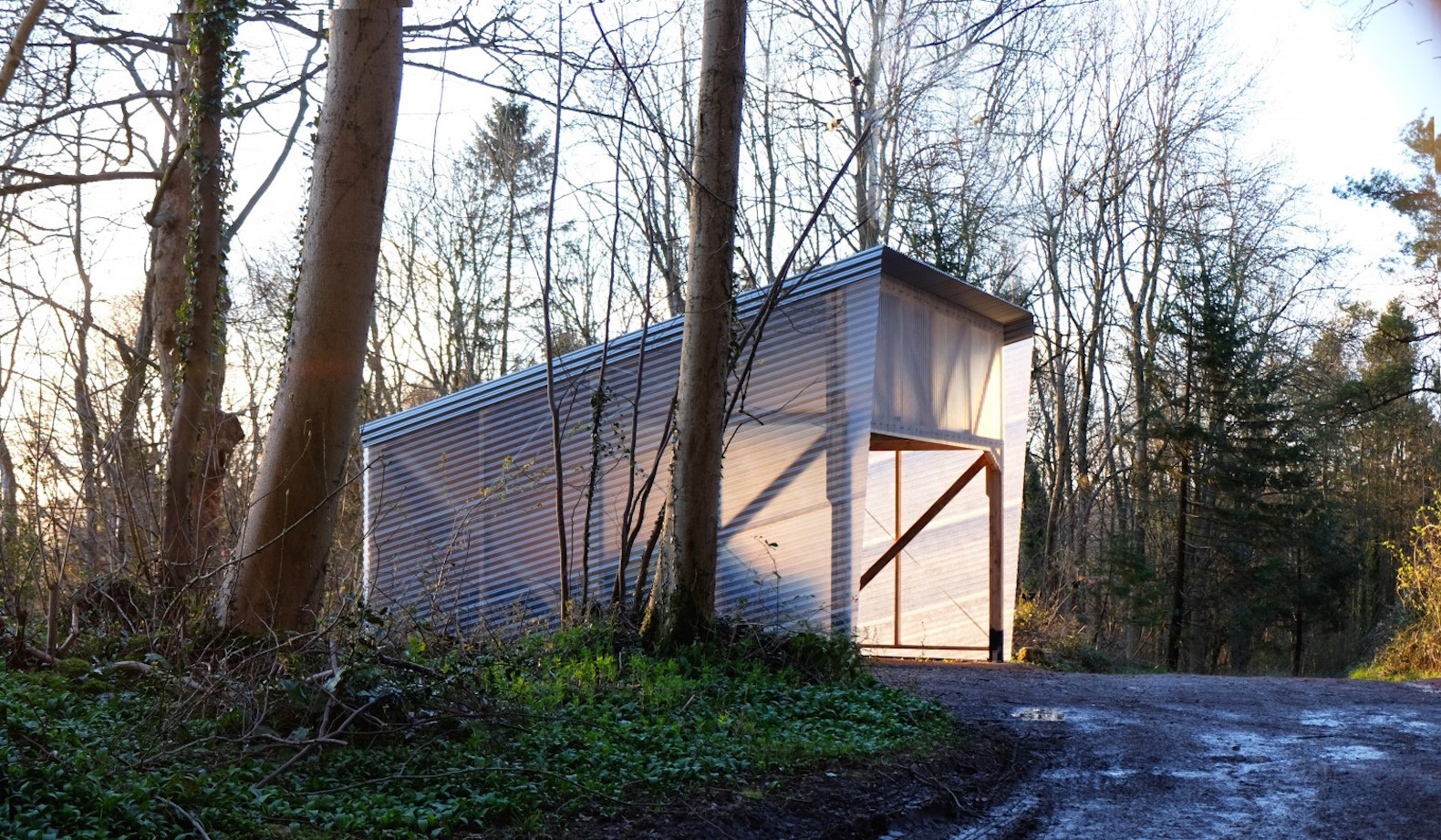Ghost Barn built of locally felled timber glows like a lantern at night