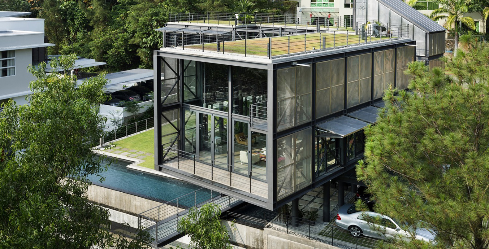 Green Roofed Cantilever House Floats Above The Malaysian Rainforest