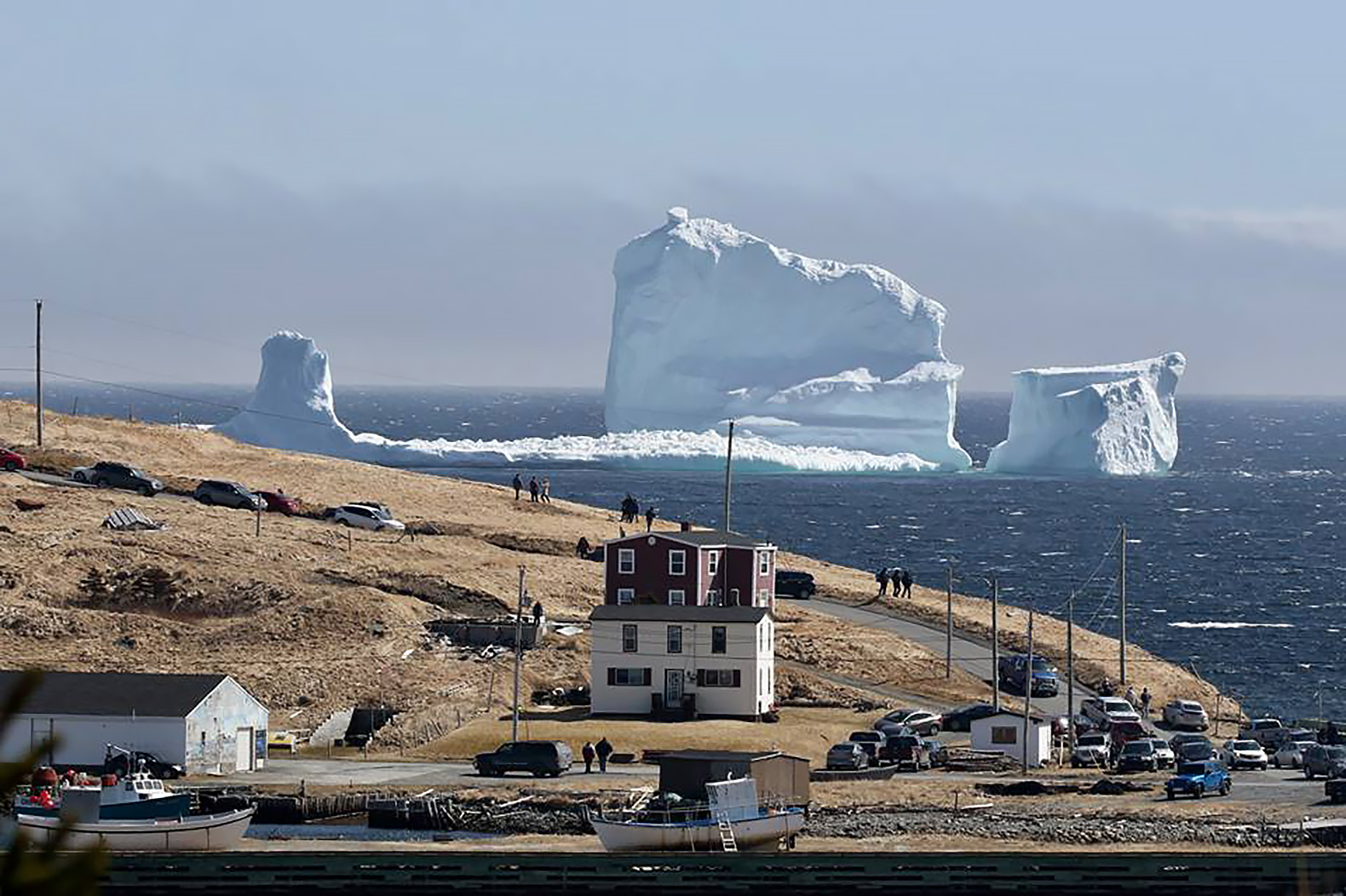Massive iceberg draws tourists to tiny Canadian town