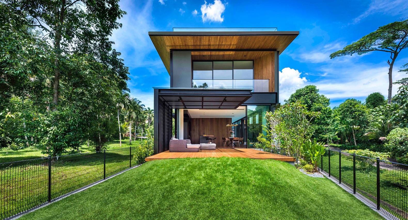 The breeze blows straight through this stunning tropical for Green building house design