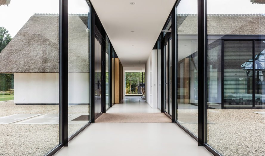 Modern Countryside Villa, Maas Architecten, the Netherlands, greenhouse, courtyard, thatched roof, timber facade, glass facade, green architecture, natural light, storage space, swimming pool