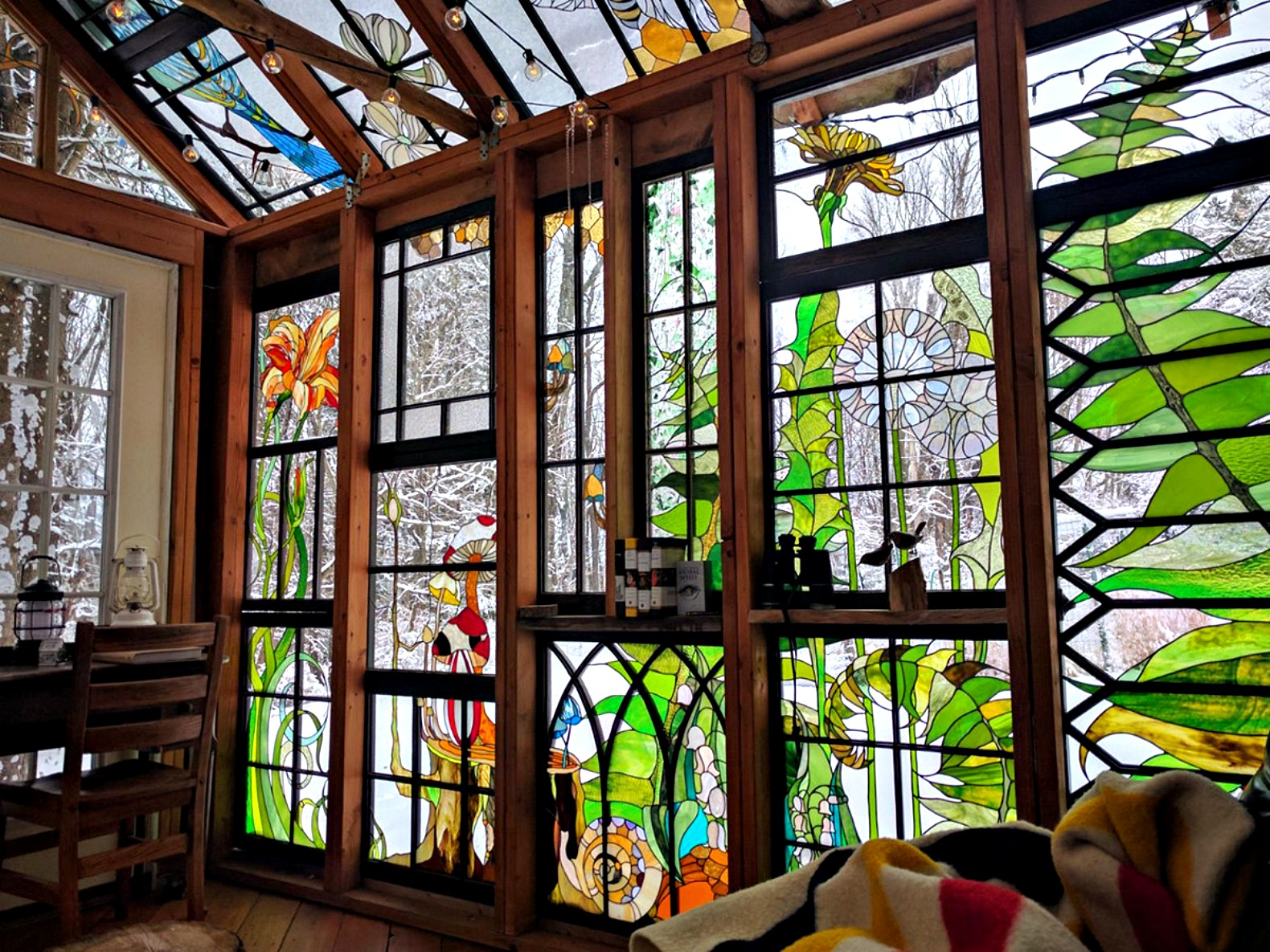 Artist builds incredible stained glass cabin in the middle for Architecture windows