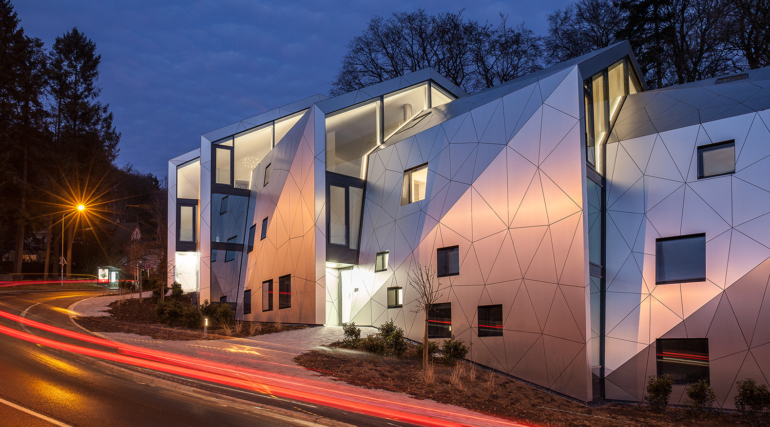 This futuristic metal-clad residence is segmented like a lobster tail