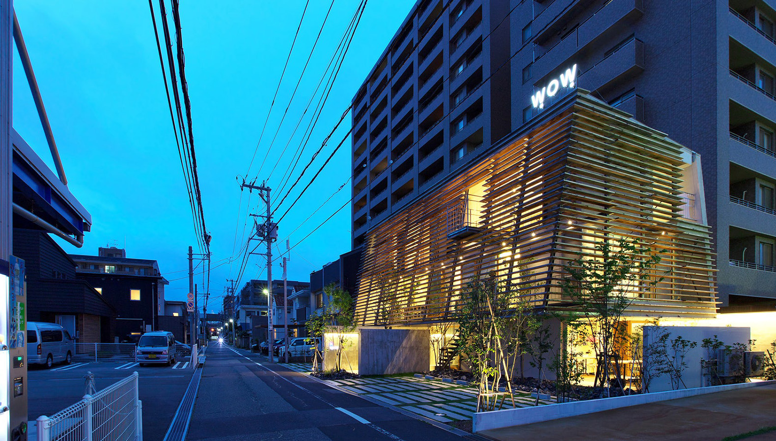 This gorgeous glowing building is wrapped in an elegant slatted screen